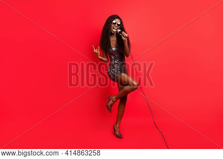 Full Body Photo Of Young Afro Girl Sing Song Microphone Star Show Rock Sign Celebrity Isolated Over