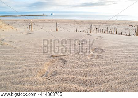 Footprints In The Sand Looking Out To Sea At South Shields Beach, A Seaside Town Near Newcastle Upon