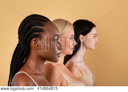 Profile Shot Of Three Beautiful Body Positive Multiracial Women Over Beige Background