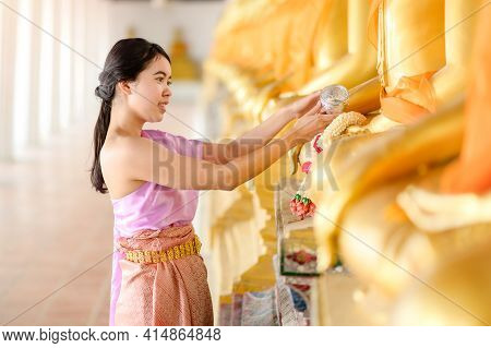 Thai Beautiful Women In Traditional Thai Dress Use Fresh Flower Garlands To Pay Homage To The Buddha
