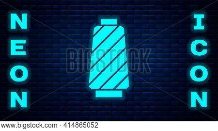 Glowing Neon Sewing Thread On Spool Icon Isolated On Brick Wall Background. Yarn Spool. Thread Bobbi