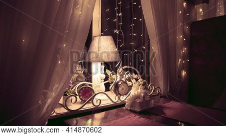 Close-up Of Elegant Cafe Or Restaurant With Luxury Interior. Decorative Clocks, Lights On Window And