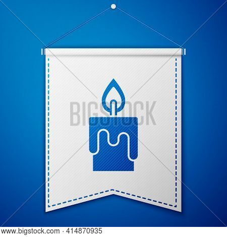 Blue Burning Candle Icon Isolated On Blue Background. Cylindrical Candle Stick With Burning Flame. W