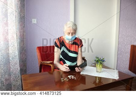 Senior Woman Sitting At Home With Pills.