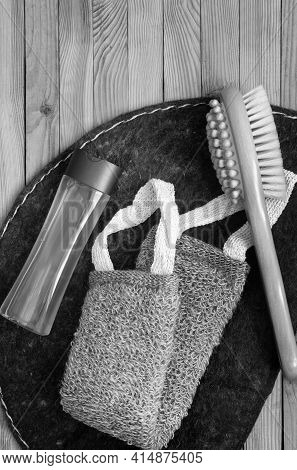 Accessories For Visiting A Bath Or Sauna On A Wooden Background: A Washcloth, A Mat, A Massage Brush