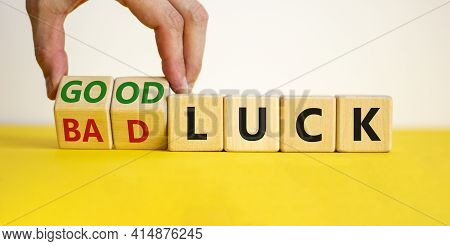 Good Or Bad Luck Symbol. Businessman Turns Wooden Cubes And Changes Words 'bad Luck' To 'good Luck'.