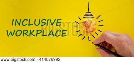 Inclusive Workplace Symbol. Businessman Writing Words 'inclusive Workplace', Yellow Background. Ligh