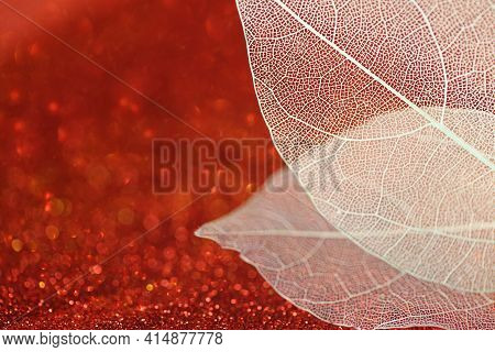 Skeleton Leaves.skeletonized Yellow Leaf On Red Glitter Background With Shining Bokeh.wallpaper Phon