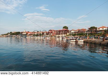 Nessebar, Bulgaria - July 20, 2014: Coastal View Of Nessebar Old Town. Ordinary People Walk The Stre