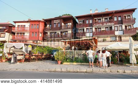 Nessebar, Bulgaria - July 20, 2014: Old Town Street View With Wooden Houses. Tourists Are On The Str