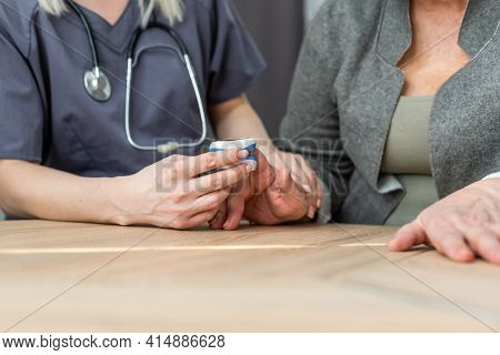 Medic And Patient Using Finger Pulse Oximeter