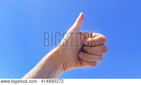 Hands With Thumb Up Over Blue Sky