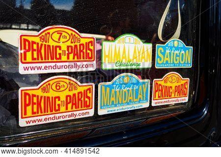 Different Stickers Of Motor Challenges - Peking To Paris, Himalayan, Mandalay, Saigon On Car. Ufa, R