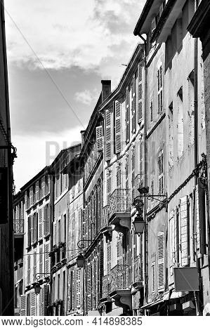 Shutters On The Windows Of Townhouses In The City Of Aix-en-provence In France, Monochrome