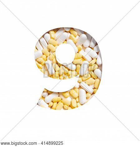 Number Nine Made Of Pills And Paper Cut In Shape Of Ninth Numeral. Typeface Of Vitamins And Nutritio