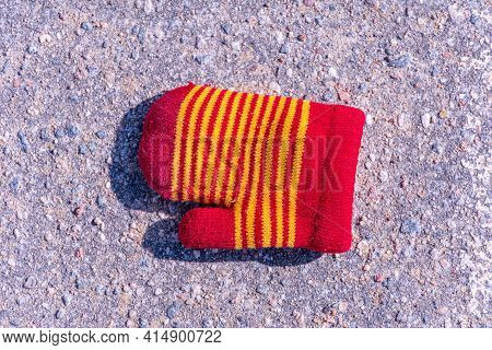 Lost Baby Mitten On The Pavement, Knitted Baby Mitten