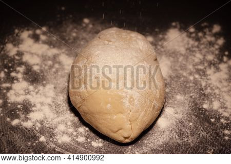 A Piece Of Dough On A Table. Piece Of Dough On The Board