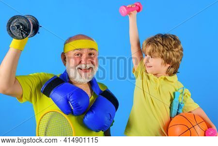Family Sport. Grandfather And Grandson Workout Together. Grandfather And Child Do Morning Exercise.