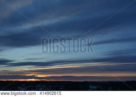 Landscape With Sunset At Winter. Dark Blue Striped Clouds On The Sky