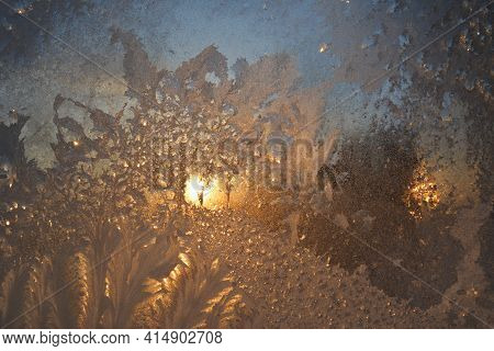 Window With Frost At Dawn In Winter