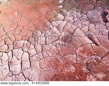 Extremely Dry Red Soil With Broken Ground