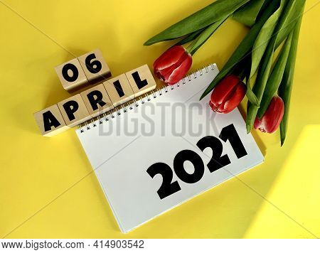 April 6 On Wooden Cubes.next To It Are Tulips And A White Notebook With The Inscription 2021 On A Ye