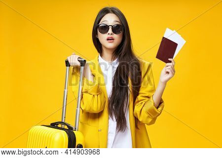 Asian Woman Passport And Plane Tickets Passenger Airport Baggage