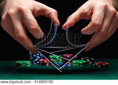Close-up Hands Of A Person-dealer Or Croupier Shuffling Poker Cards In Casino On The Background Of A