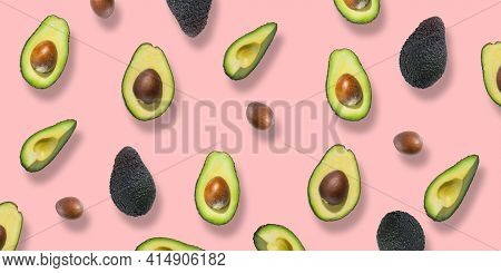 Pattern Of Fresh Ripe Green Avocados. Avocado Banner. Avocado Pieces And Halves Isolated On A Pink B