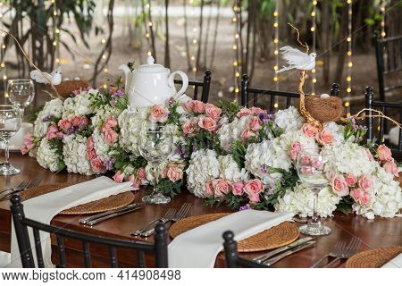 A Centerpieces, Decorated Table For Party Reception.