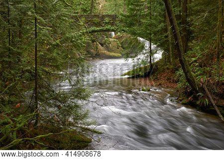 Whatcom Falls Bridge Washington State. Whatcom Creek And The Historic Stone Bridge Crossing It. Bell