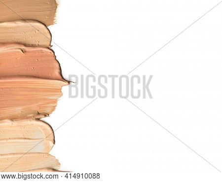 Foundation smuges, face make-up samples. Set of cosmetic liquid foundation or cream in different colour smudge smear strokes. Make up smears isolated on a white background. Foundation colors palette.