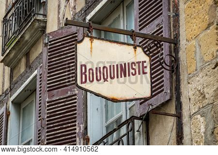 Vintage French sign reads bookstore, retro and weathered bookshop sign, in France