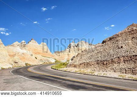 Road through the harsh landscape of Badlands National Park.