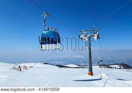 Gondola lift at ski resort in winter