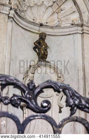 Brussels, Belgium - May 04, 2017: Famous Pissing Boy statue (Manneken Pis) in Brussels Belgium.