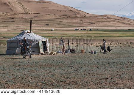 WESTERN MONGOLIA, - JUNE 2019: Mongolian nomadic traditional yurt. Camp in the border of the sandy desert. Mongol-Els, Western Mongolia.