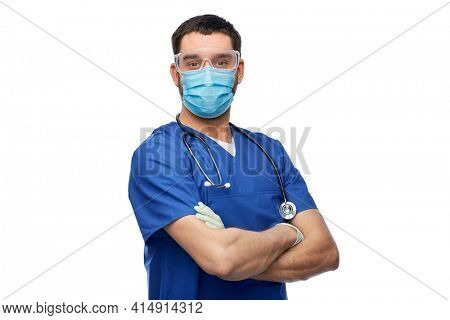 healthcare, profession and medicine concept - doctor or male nurse in blue uniform, face protective medical mask for protection from virus disease, goggles and gloves over white background