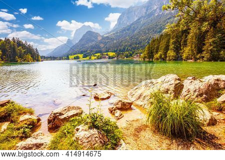 Spectacular scene of alpine lake Hintersee. Location place Ramsau, National park Berchtesgadener Land, Upper Bavaria, Germany, Europe. Adventure outdoor summer vacations. Discover the beauty of earth.