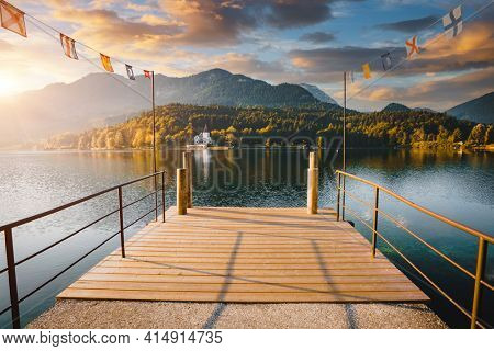 Spectacular view from a wooden pier on the calm lake Grundlsee. Location place resort Grundlsee, Liezen District of Styria, Austria, Europe. Vibrant photo wallpaper. Discover the beauty of earth.