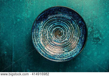 Pottery bowl or ceramics in green and blue tone. Kitchenware