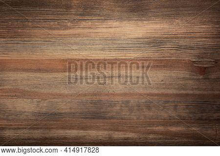Aged wooden background of table or wall texture. Brown wood tabletop with copy space