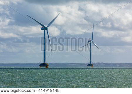Two large wind turbines in the Limfjord inlet near Thyborøn