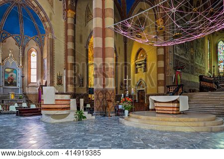 ALBA, ITALY - JUNE 12, 2020: Interiors of San Lorenzo Cathedral (aka Duomo) in Alba - small town in Piedmont region in Northern Italy, famous for white truffles and wine production.