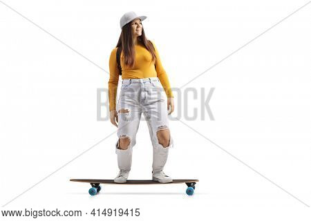 Full length shot of a skater girl riding a longboard isolated on white background