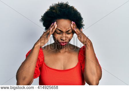 Young african american woman wearing casual clothes with hand on head for pain in head because stress. suffering migraine.