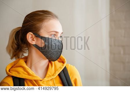Young Beautiful Woman Student Wearing Protective Mask Portrait With Backpack. Teen Girl Blonde Cauca