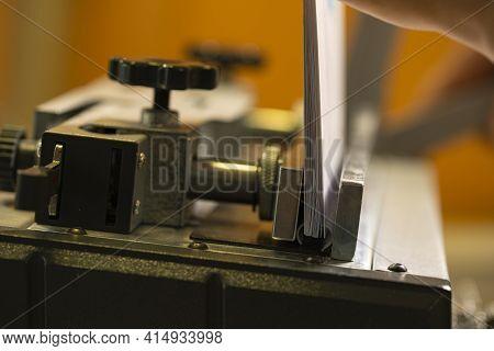 Typography Machine For Spiral Notebook In Workshop
