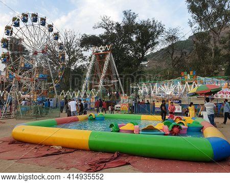 Mandi, Himachal Pradesh, India - 03 14 2021: People Enjoying Maha Shivaratri Carnival Fair (mela) Du