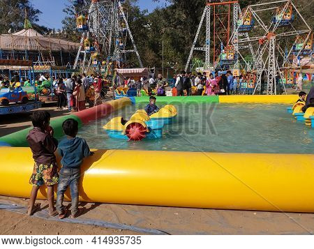 Mandi, Himachal Pradesh, India - 03 14 2021: Photo Of People And Kids Enjoying Maha Shivaratri Carni